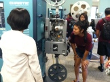 Janel sharing about the projectors w/ the Pueo Program